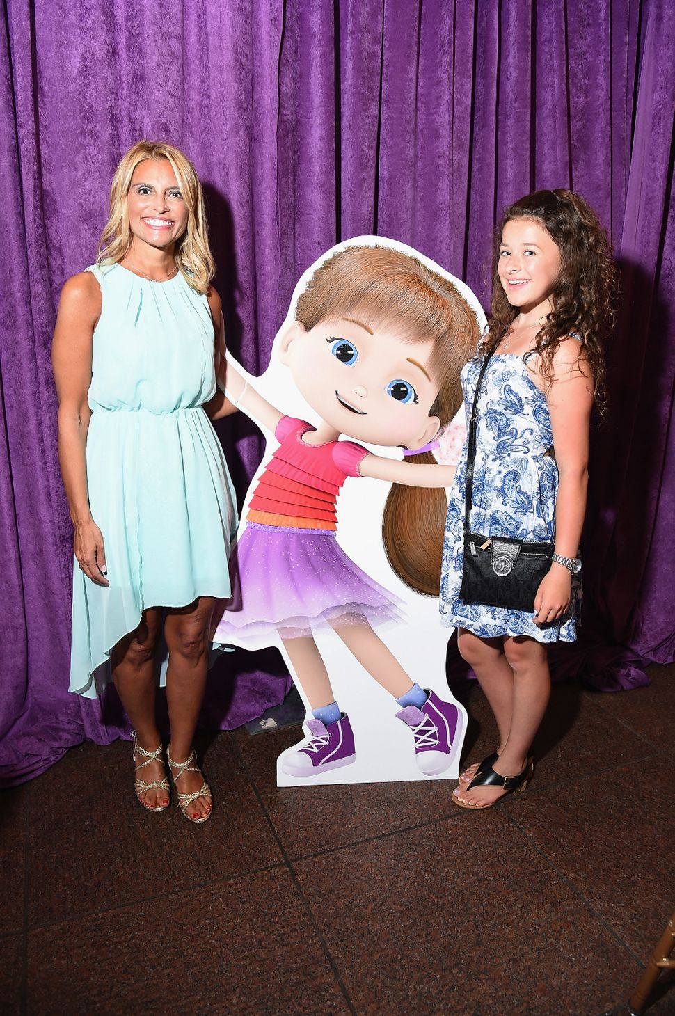 "Angela Santomero (left) and actress Addison Holley attend the premiere screening event for her Amazon Original Kids Series ""W"