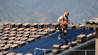 CORONA, CA - MAY 03: Workers install solar panels on the roofs of homes under construction south of Corona Thursday morning May 3, 2018. The California Energy Commission voted 5-0 Wednesday, May 9, to adopt new energy building standards requiring solar panels for virtually all new homes built in the state starting in 2020. The decision likely will make California the first state in the nation requiring solar for new houses and low-rise condos and apartments.'n (Photo by Will Lester/Inland Valley Daily Bulletin via Getty Images)