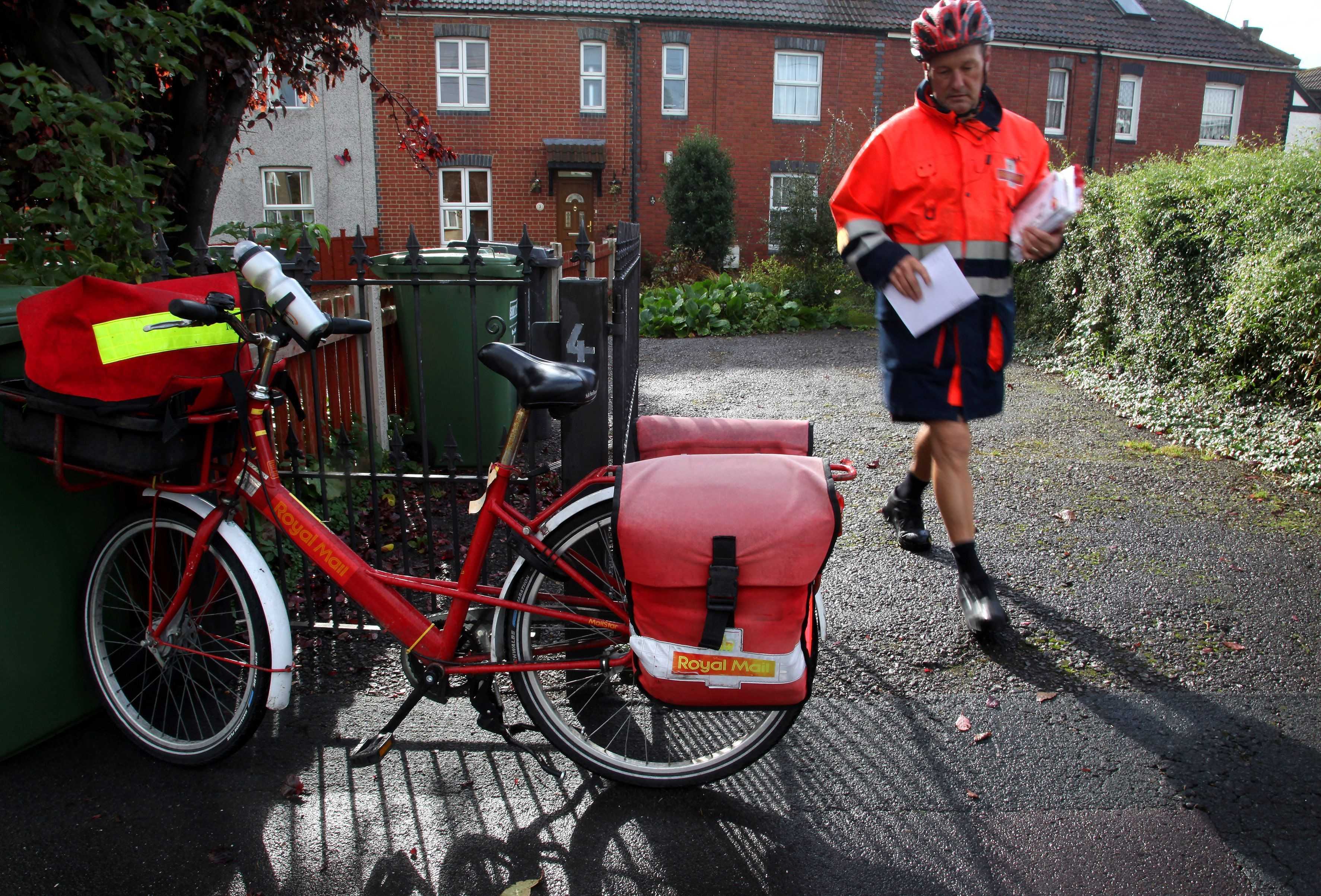 Postman Gerry Cryer delivering the post in Bristol.