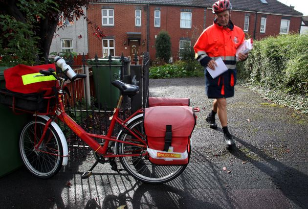 Postman Gerry Cryer delivering the post in