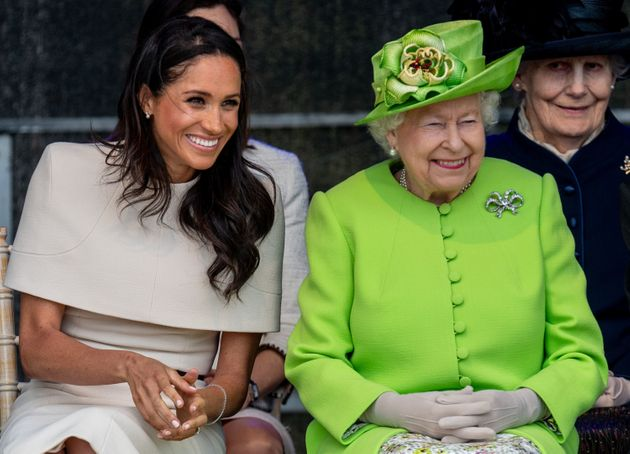 Queen Elizabeth II and Meghan, Duchess of Sussex, during a visit to the Catalyst Museum in Widnes, England,...