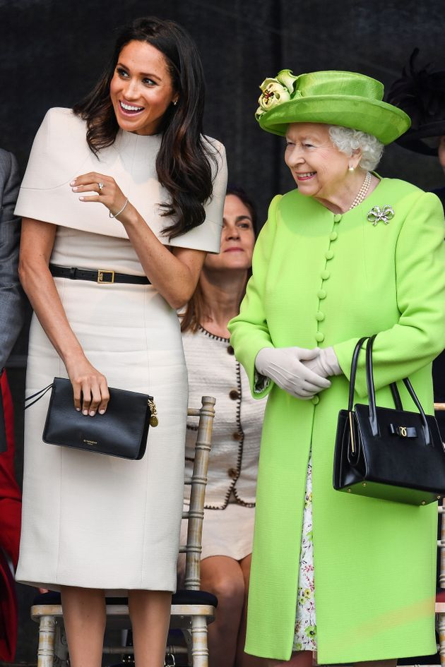 The queen stands with the Duchess of Sussex during a ceremony to open the new Mersey Gateway Bridge on...