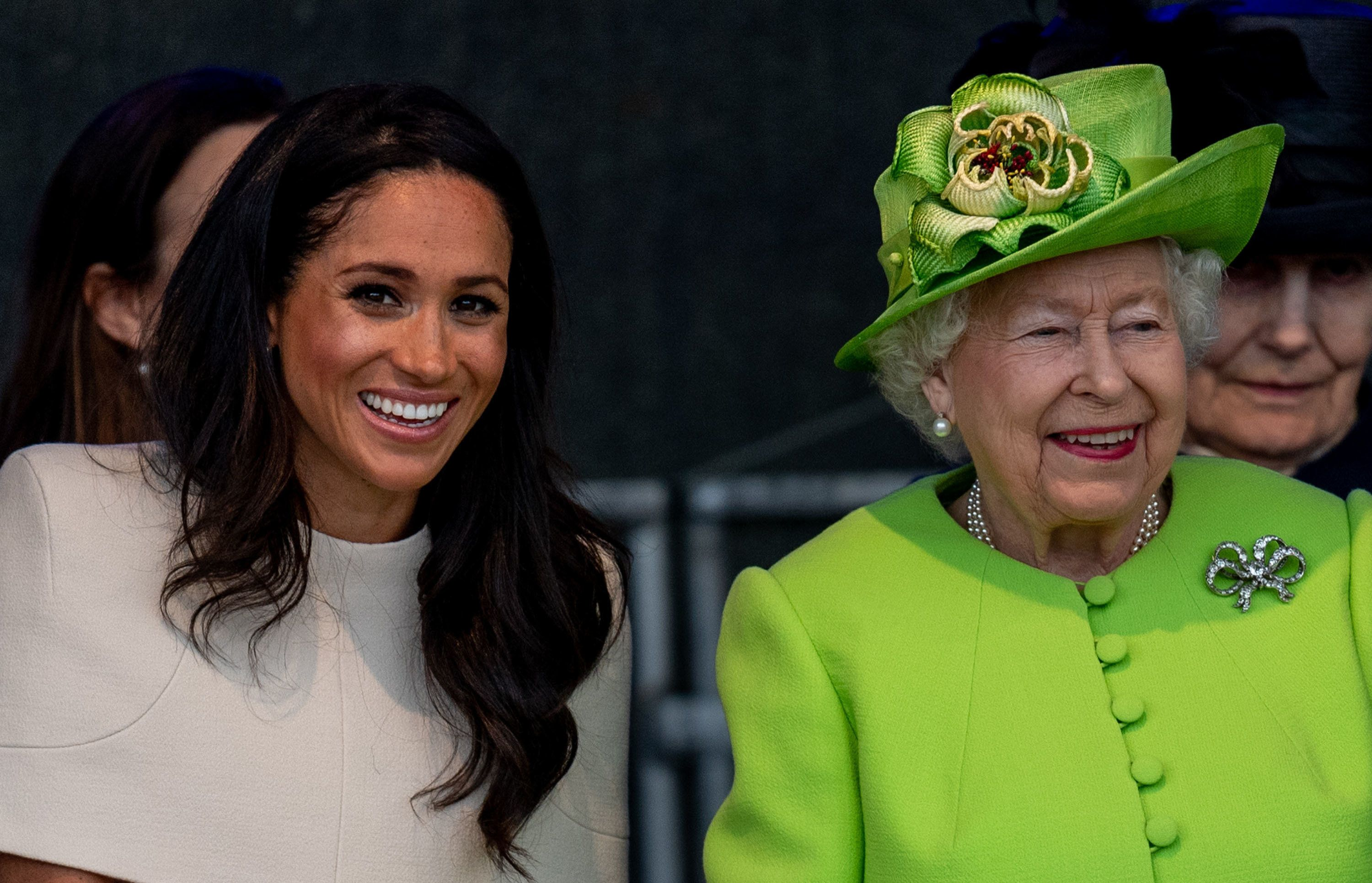 WIDNES, ENGLAND - JUNE 14: Queen Elizabeth II and Meghan, Duchess of Sussex  during a visit to the Catalyst Museum by the Mersey Gateway Bridge on June 14, 2018 in Widnes, England. Meghan Markle married Prince Harry last month to become The Duchess of Sussex. This is her first engagement with the Queen. During the visit the pair will open a road bridge in Widnes and visit The Storyhouse and Town Hall in Chester. (Photo by Mark Cuthbert/UK Press via Getty Images)