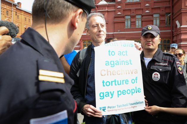 Tatchell is questioned and led away by Russian authorities in