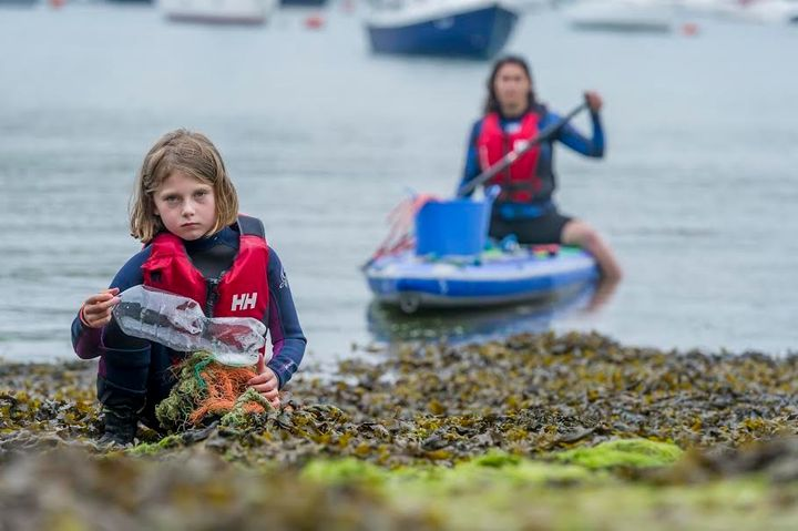 Ella collected plastic rubbish while paddleboarding in the Salcombe-Kingsbridge estuary with her mum Anna Turns.