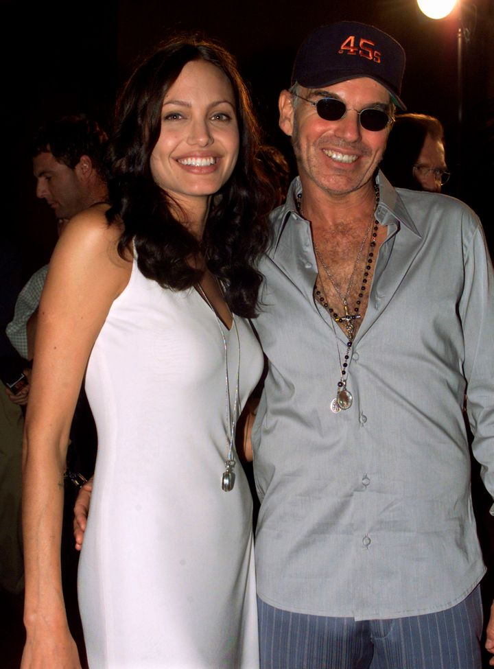 Jolie and Thornton are wearing what looks like their matching vials of blood below in a photo from July 31, 2001.