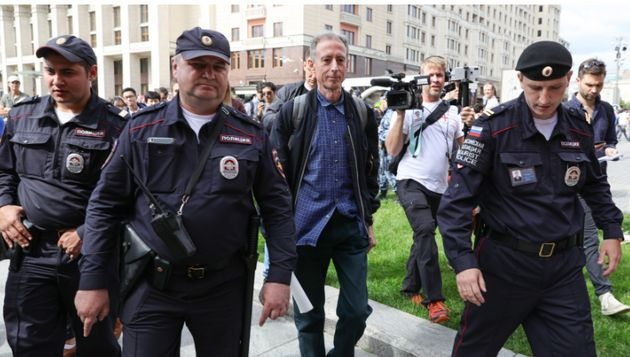 Peter Tatchell was freed on bail after staging a one-man protest near the