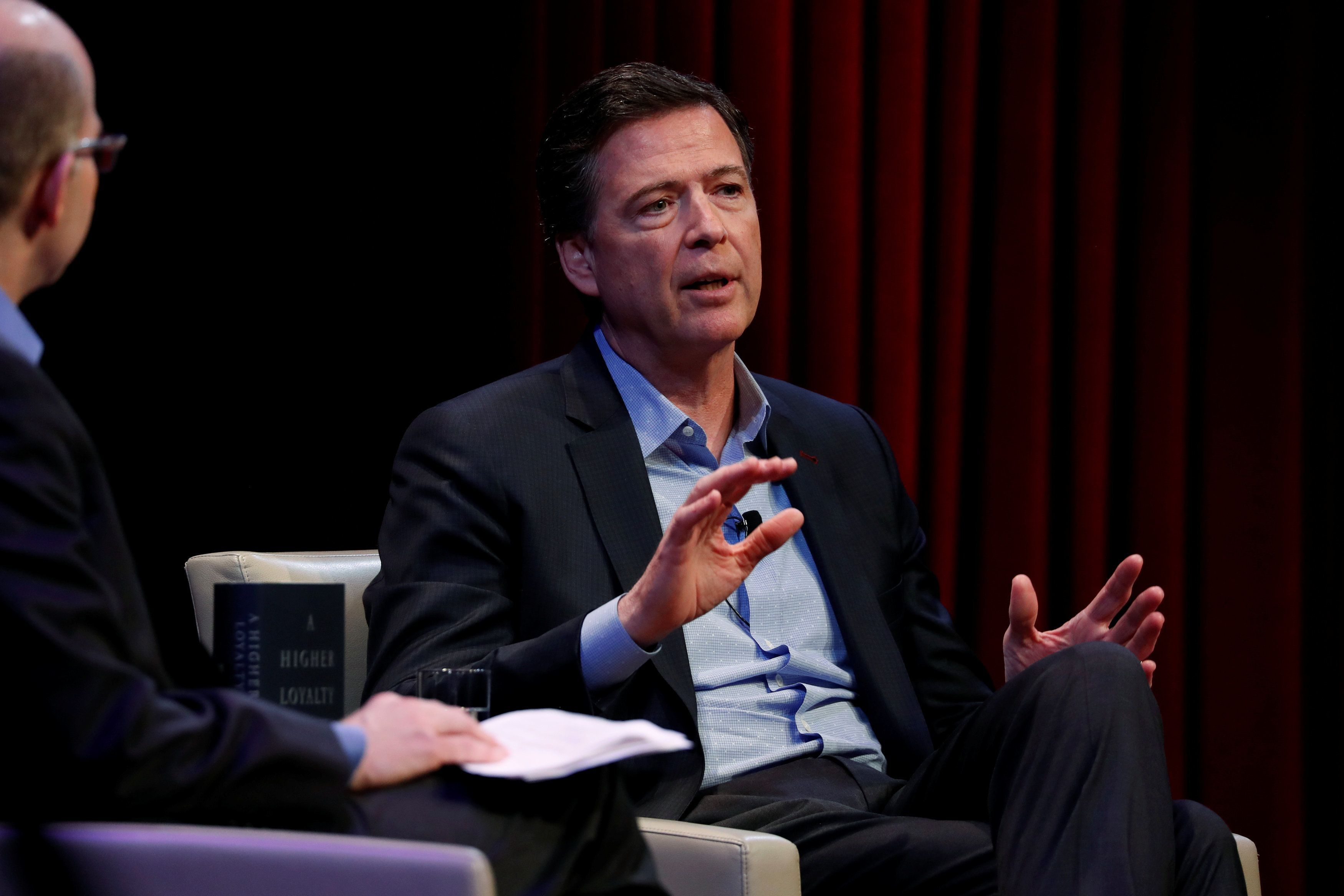 Former FBI director James Comey speaks about his book during an onstage interview with Axios  Executive Editor Mike Allen at George Washington University in Washington, U.S. April 30, 2018.  REUTERS/Jonathan Ernst