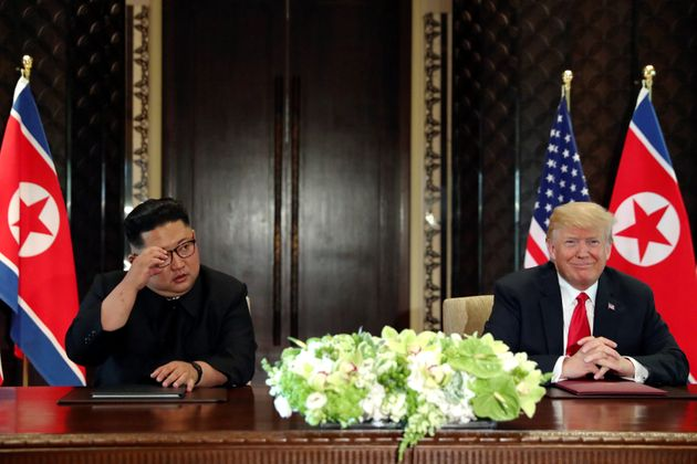 North Korean leader Kim Jong Un andPresident Donald Trumphold a signing ceremony at the conclusion...