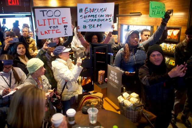 Protesters demonstrate in a Philadelphia Starbucks on April 15, 2018, days after an employee...