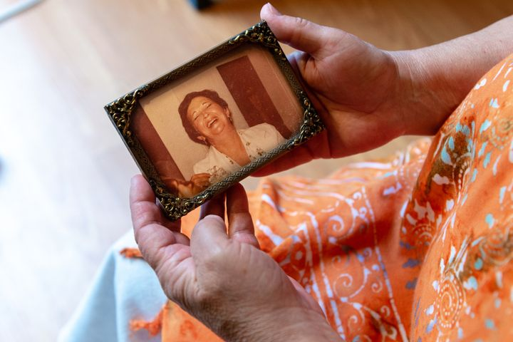 Deborah Ann Favorite holds a photograph of her mother, Elaine Essa. The nursing home and Essa's primary care practice settled