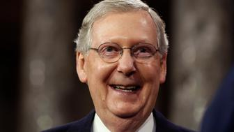 U.S. Senate Majority Leader Mitch McConnell smiles after he ceremonially swore-in, in the Old Senate Chamber on Capitol Hill in Washington January 6, 2015.     REUTERS/Larry Downing   (UNITED STATES - Tags: POLITICS)