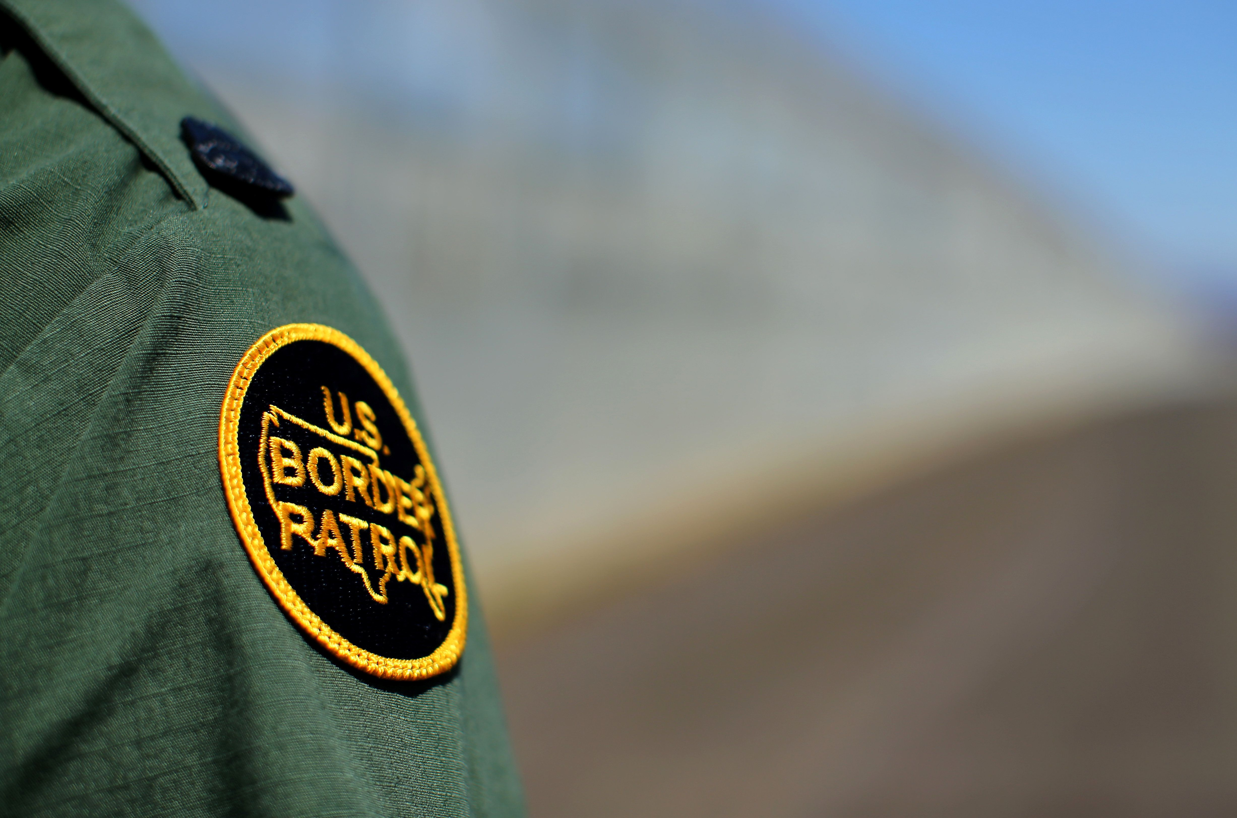A U.S. Customs and Border Patrol officer stands along the secondary fence between the  U.S. and Mexico in San Diego, California, U.S. April 21, 2017.  REUTERS/Mike Blake