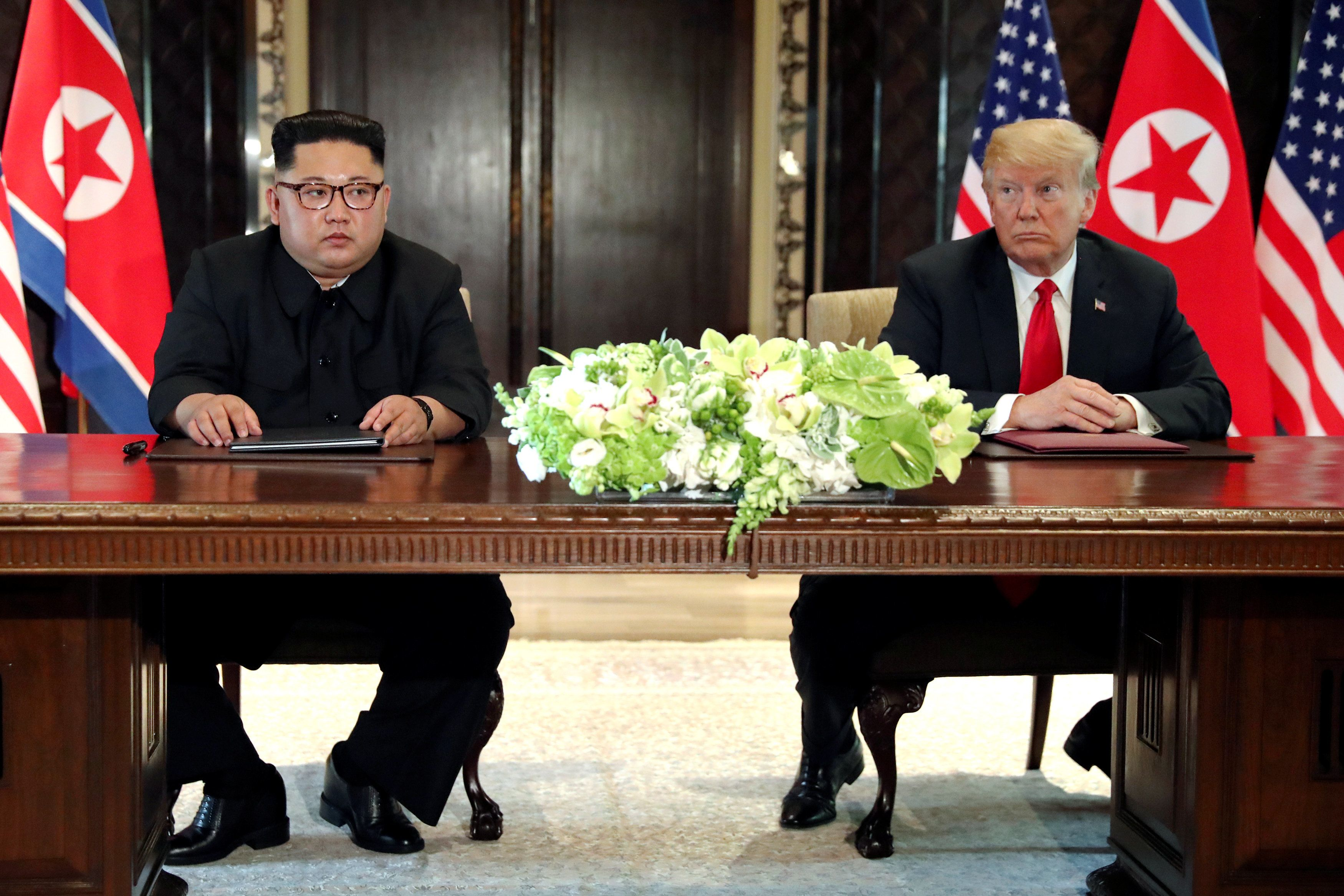 U.S. President Donald Trump and North Korea's leader Kim Jong Un hold a signing ceremony at the conclusion of their summit at the Capella Hotel on the resort island of Sentosa, Singapore June 12, 2018. Picture taken June 12, 2018. REUTERS/Jonathan Ernst