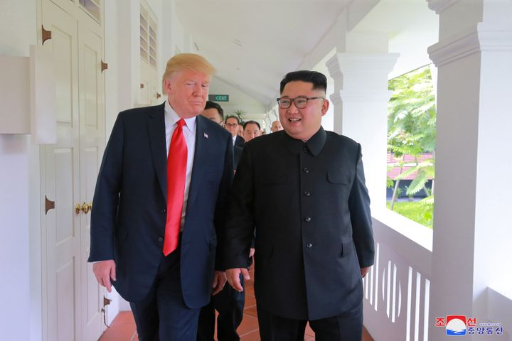 President Donald Trump walks with North Korean leader Kim Jong Un at the Capella Hotel in Singapore on June 12.