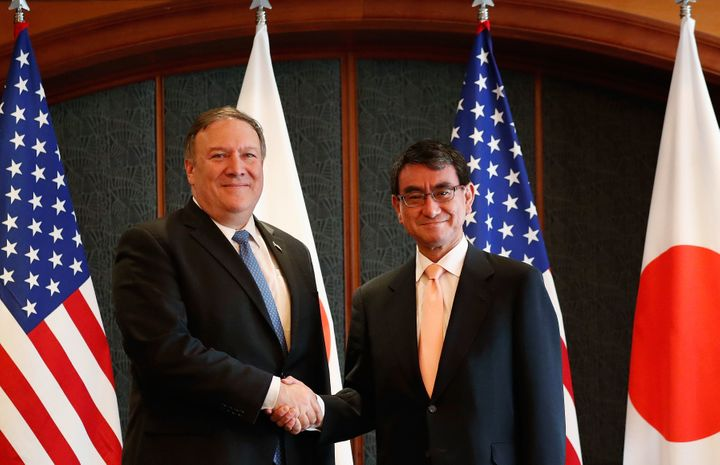 Secretary of State Mike Pompeo shakes hands with Japanese Foreign Minister Taro Kono before their meeting at South Korea's fo