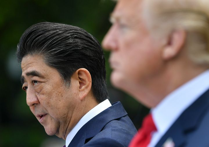 President Donald Trump looks on as Japanese Prime Minister Shinzo Abe speaks during a joint press conference in the Rose Gard