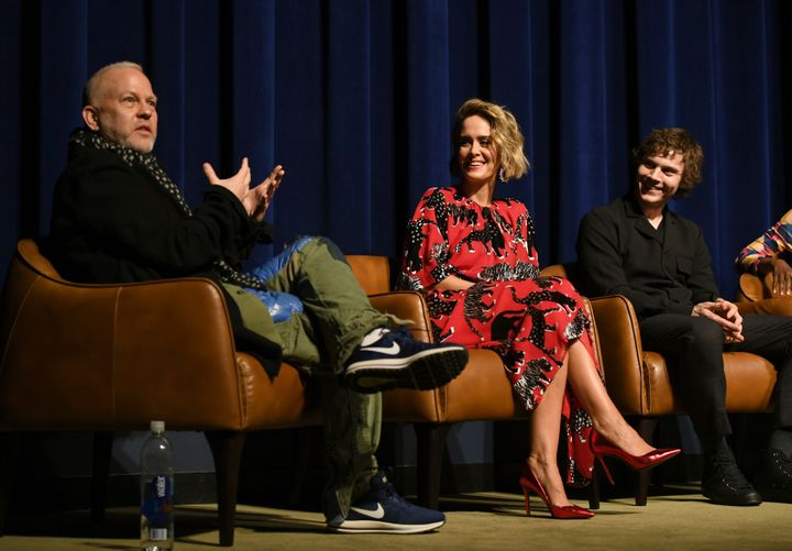 """Ryan Murphy, Sarah Paulson and Evan Peters speak onstage at an """"American Horror Story"""" event in April."""