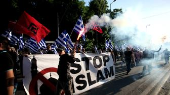 A banner reads Stop Islam during a rally held by Golden Dawn members and supporters in Syntagma square in Athens, Greece on May 29, 2018 to commemorate the conquest of Istanbul from the Ottoman Turks, on May 29, 1453. (Photo by Giorgos Georgiou/NurPhoto via Getty Images)
