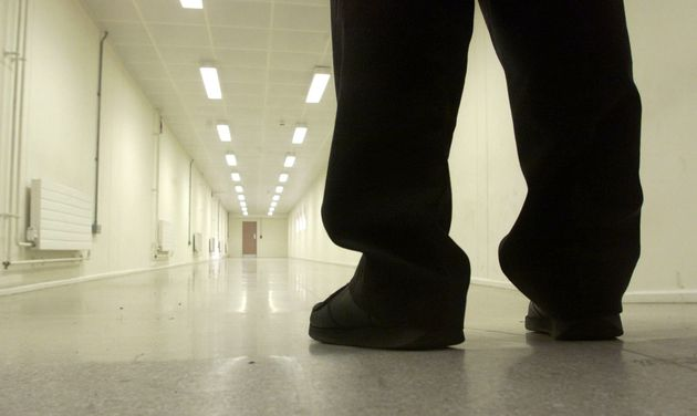A Group 4 security officer walks down one of the corridors of Yarl's Wood Immigration Removal Centre, Europe's largest detention centre for illegal immigrants, in Bedford January 17, 2002