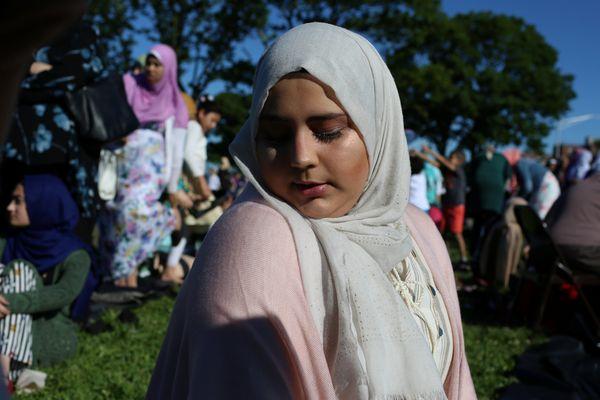 A Muslim woman prays at Bensonhurst Park in Brooklyn, New York, to celebrate Eid al-Fitr on June 15, 2018.
