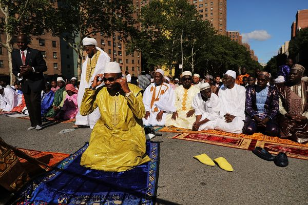 Muslims participate in an outdoor prayer event at Masjid Aqsa-Salam mosque, an annualgathering in Harlem that attracts