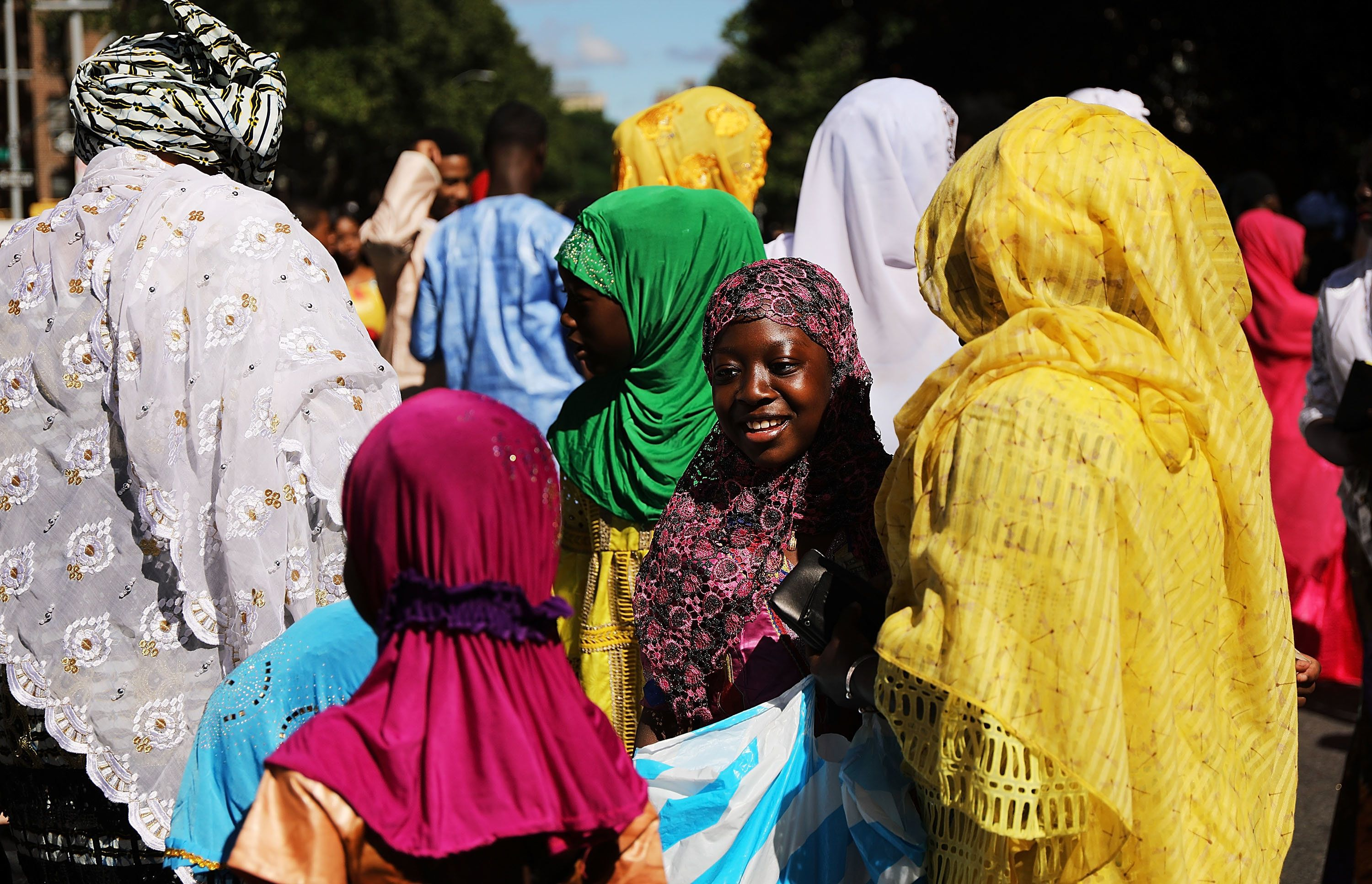 Women gather after participating in an outdoor prayer event at Masjid Aqsa-Salam mosque, Manhattan's oldest West African mosq