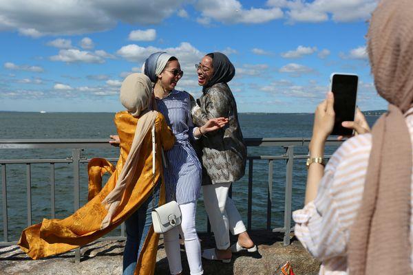 Maryam Said, 19, Eman Gad, 20, and Hallah Towfiek, 20, get their photos taken after morning prayers at Bensonhurst Park