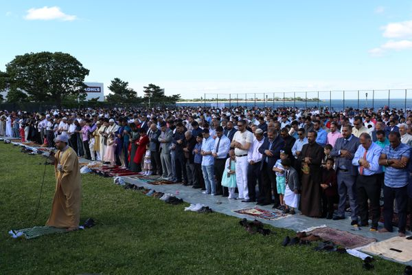 Muslims pray at Bensonhurst Park to celebrate Eid al-Fitr.