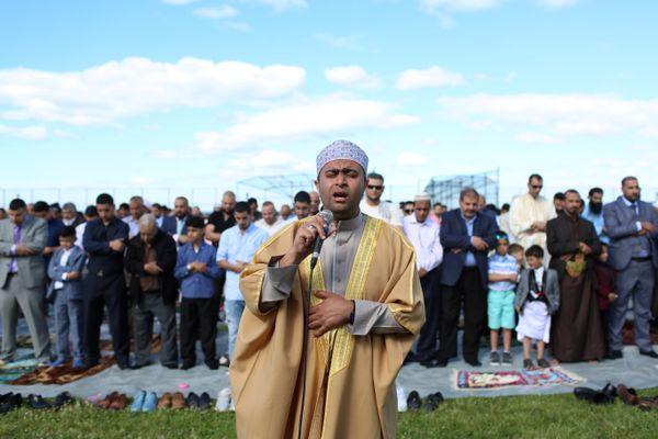 An imam leads Eid al-Fitr prayers at Bensonhurst Park to mark the end of Ramadan on June 15.