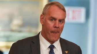 US Secretary of the Interior Ryan Zinke looks on before a luncheon with French President Emmanuel Macron and US Vice President Mike Pence at the US State Department in Washington, DC on April 24, 2018. (Photo by Andrew CABALLERO-REYNOLDS / AFP)        (Photo credit should read ANDREW CABALLERO-REYNOLDS/AFP/Getty Images)