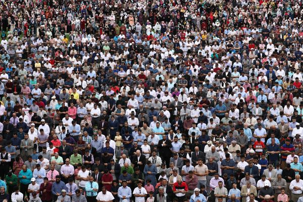 Muslims perform Eid al-Fitr prayers after the end of Ramadan at Toyota Park Stadium in Chicagoon June 15.