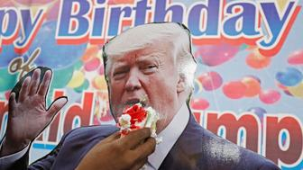 A member of Hindu Sena, a right wing Hindu group, celebrates U.S. President Donald Trump's birthday in New Delhi, India June 14, 2018. REUTERS/Saumya Khandelwal