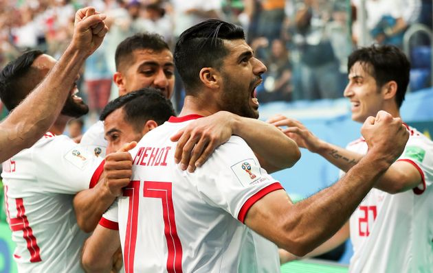 Mehdi Taremi of Iran and his team-mates celebrate their goal during the 2018 FIFA World Cup Russia group...