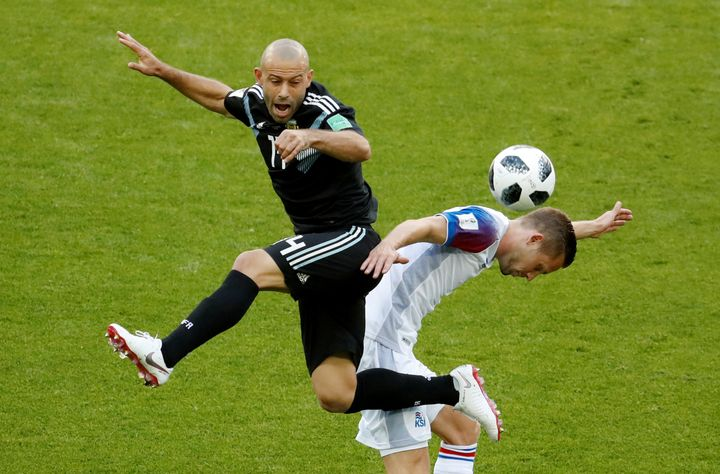 Argentina's Javier Mascherano in action with Iceland's Gylfi Sigurdsson.