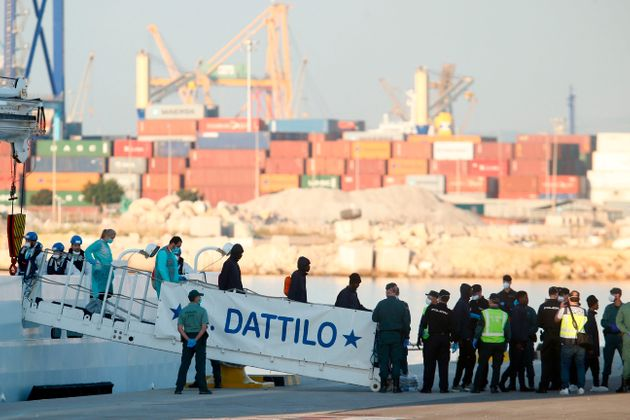 Migrants disembark from the Italian coast guard boat the Dattilo at the port of Valencia on June