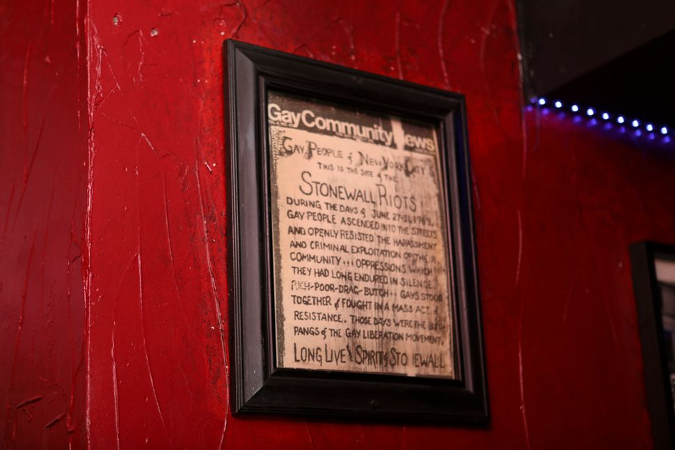 A news clipping on the historic 1969 riots hanging on the wall at New York's Stonewall Inn.