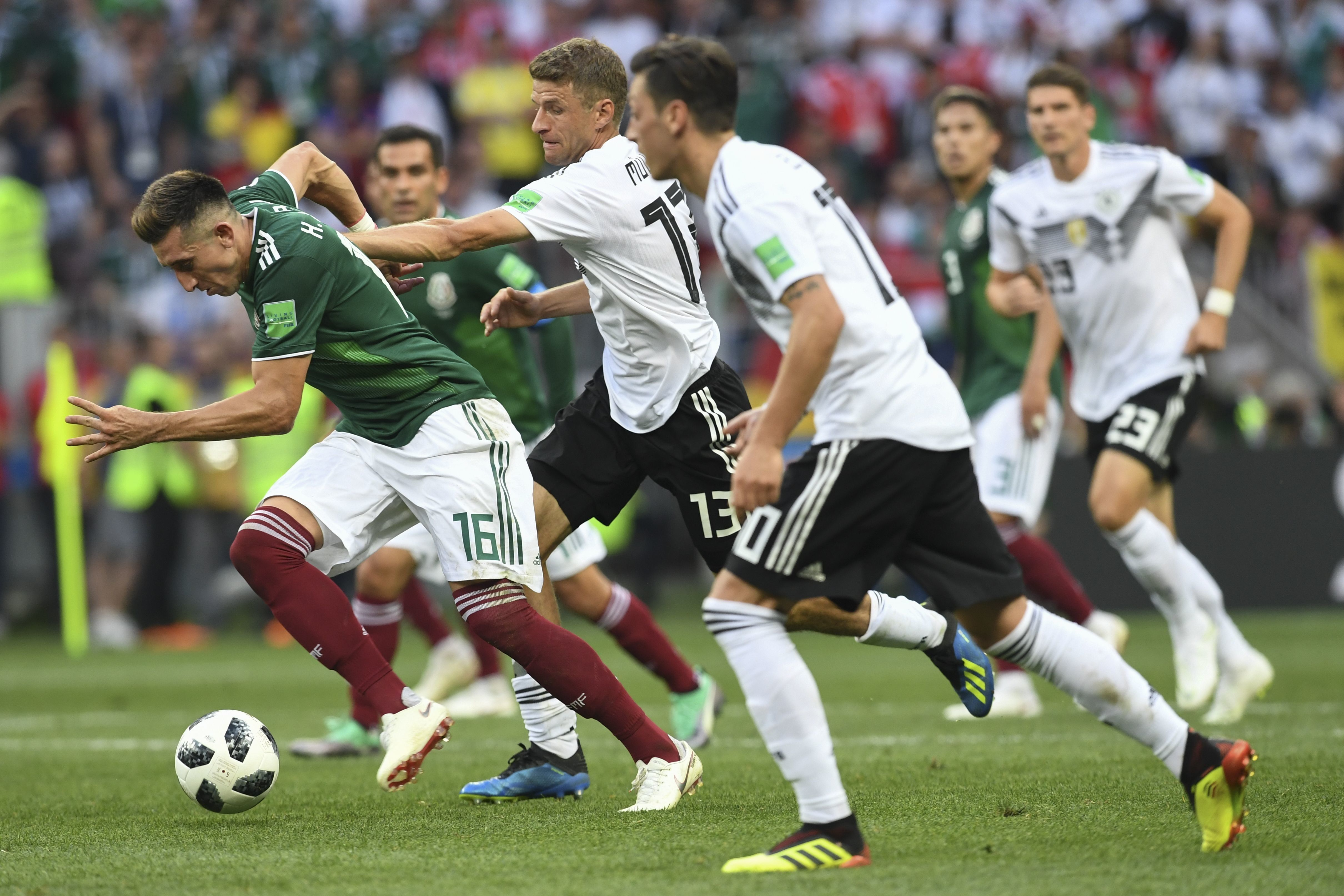 Mexico's midfielder Hector Herrera (L) is marked by Germany's forward Thomas Mueller (2nd-L) during the Russia 2018 World Cup Group F football match between Germany and Mexico at the Luzhniki Stadium in Moscow on June 17, 2018. (Photo by Francisco LEONG / AFP) / RESTRICTED TO EDITORIAL USE - NO MOBILE PUSH ALERTS/DOWNLOADS        (Photo credit should read FRANCISCO LEONG/AFP/Getty Images)