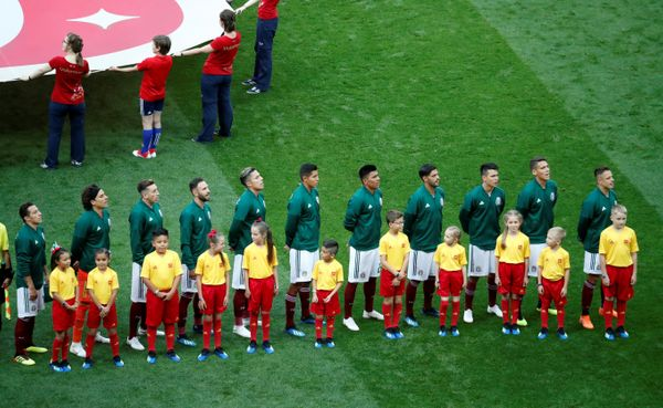 Team Mexico players line up before the match.