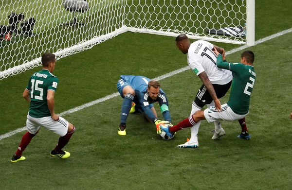 Mexico's Hirving Lozano and Hector Moreno in action with Germany's Jerome Boateng and Manuel Neuer.
