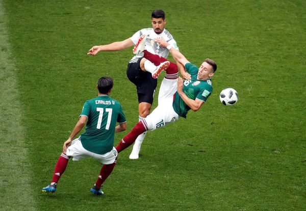Germany's Sami Khedira in action with Mexico's Carlos Vela and Hector Herrera.