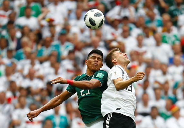 Germany's Thomas Muller in action with Mexico's Jesus Gallardo .