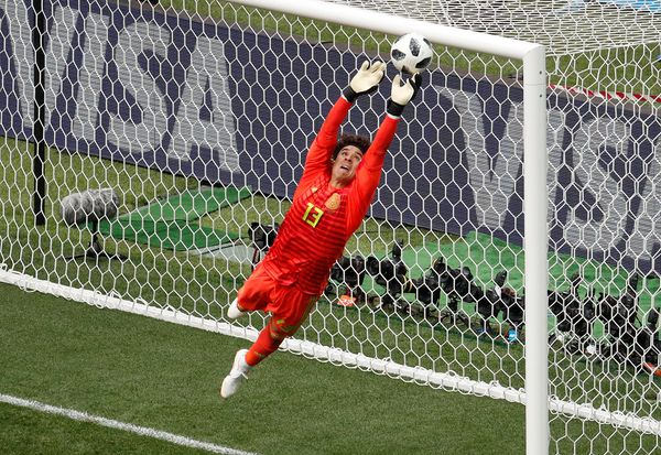 Mexico's Guillermo Ochoa makes a save.