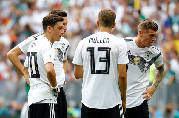 Germany's Mesut Ozil, Julian Draxler, Thomas Muller and Toni Kroos look dejected after Mexico's Hirving Lozano (not pictured)