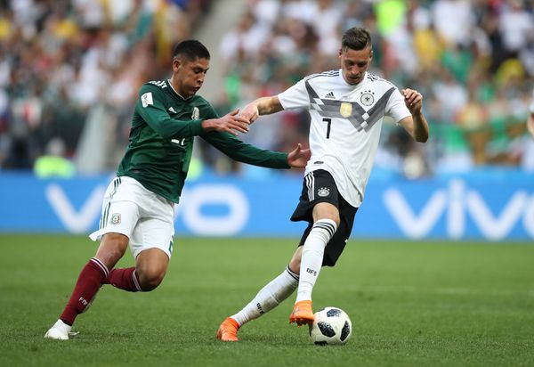 Germany's Julian Draxler in action with Mexico's Edson Alvarez.