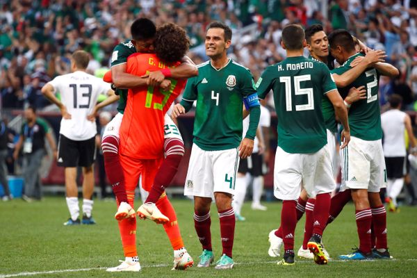 Mexico's Guillermo Ochoa celebrates victory with Jesus Gallardo and Rafael Marquez after the match.