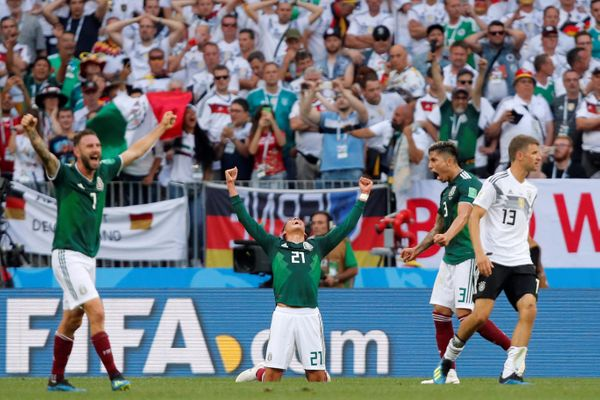 Mexico's Edson Alvarez, Miguel Layun and Carlos Salcedo celebrate at full time as Germany's Thomas Muller looks dejected.