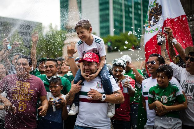 Mexicans celebrate at the Angel of Independence in Mexico