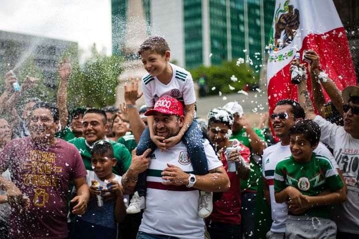 Mexicans celebrate at the Angel of Independence in Mexico City.