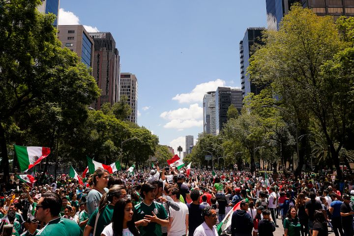 Crowds gathered to celebrate the World Cup team defeating defending champions in their first game of the competition.